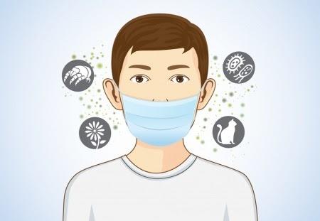 ผู้ชายสวมหน้ากากอนามัยห้องกันเชื้อโรคต่างๆได้ดี